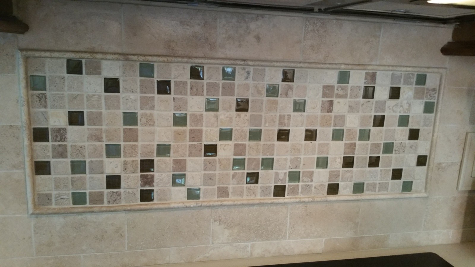 Travertine and glass back splash