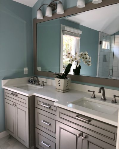 Warm gray vanity and white countertops