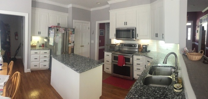 After - white painted cabinets and new hardwood floors