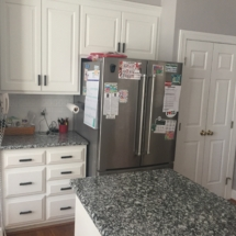 white cabinets with black and white granite