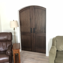 Closed barn doors appear to have arched tops when seen from living room