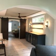 Wine room with custom-built walnut barn doors