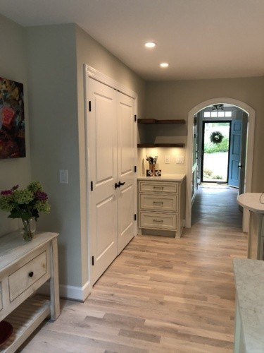 New pantry and custom walnut corner shelves, arched doorway