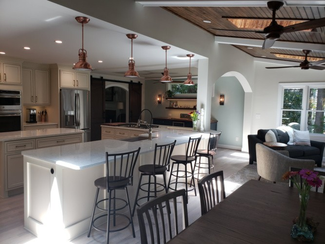 L shaped island with sink, dw, cooktop and seating