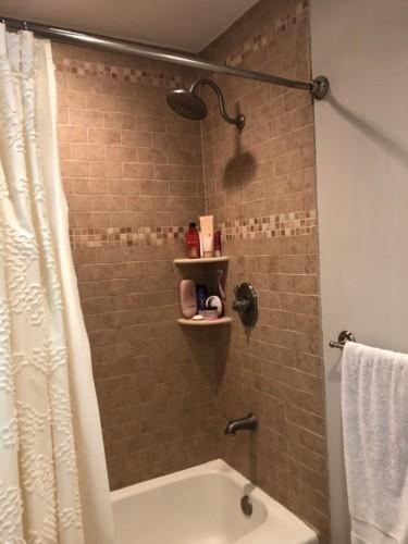 Before- old brown shower tile