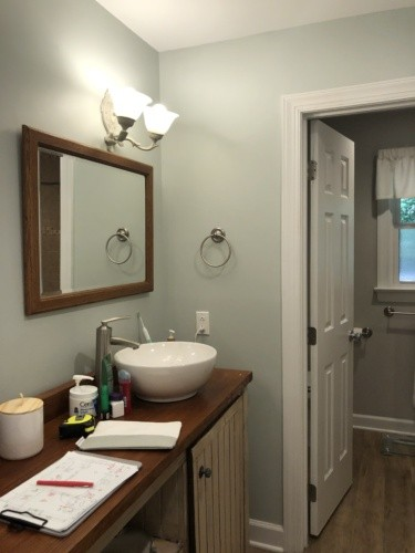 Before- Shabby chic vanity with tub and shower walled off